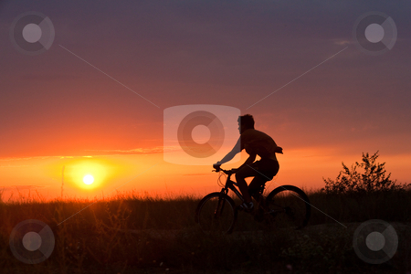 Summer cyclist stock photo, People series: summer cyclist on the sunset light by Gennady Kravetsky
