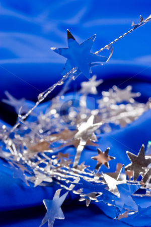 Star shaped garland stock photo, Holiday series: star shaped silver Christmas garland and bell by Gennady Kravetsky