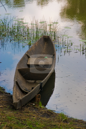 Old boat stock photo, Nature series: old wooden boat on the river by Gennady Kravetsky