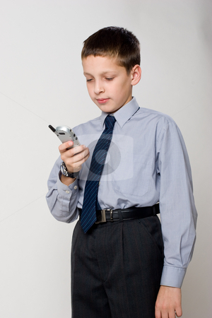 Boy with phone stock photo, Young boy talking by cell phone by Gennady Kravetsky