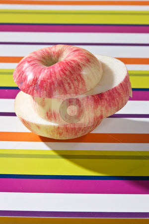 Apple stock photo, Food series: stripped sliced apple on napkin by Gennady Kravetsky