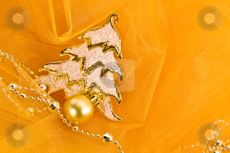 Christmas decoration stock photo, Holiday series: christmas golden fir decoration with garland on yellow by Gennady Kravetsky