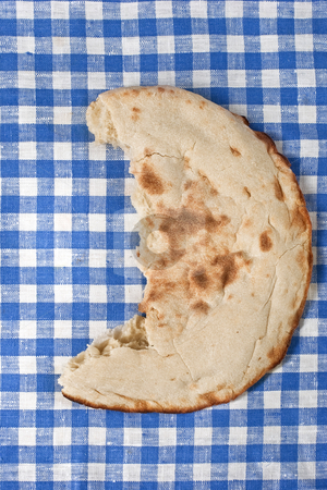 Half lavash stock photo, Food series: half lavash on the table-cloth by Gennady Kravetsky