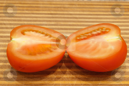 Tomato stock photo, The cut tomato on a table by Ilya Kapustnikow