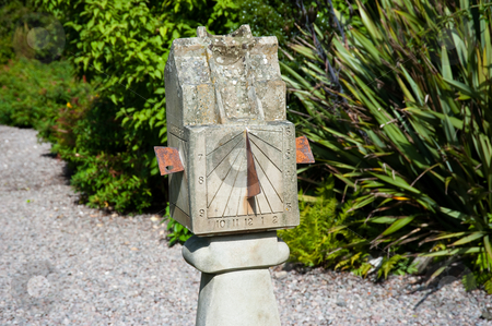 Sundial stock photo, Old sundial in a garden by Jaime Pharr
