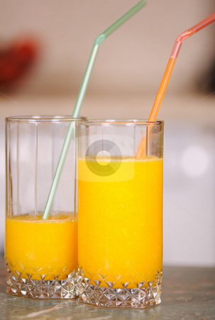 Juice in a glass stock photo, Orange juice in a glass on a table by Salauyou Yury