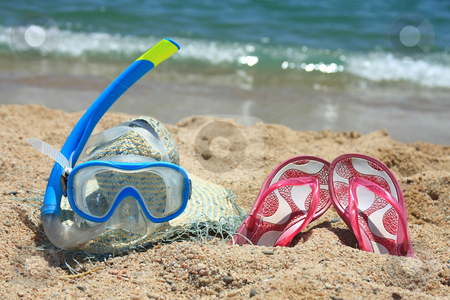 On the shore stock photo, Beach accesories on the sand in Spain by ARPAD RADOCZY