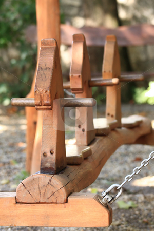 Child swing stock photo, The modern made of wood swing is safe by ARPAD RADOCZY