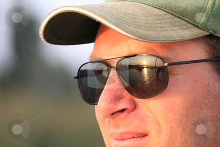 Portrait stock photo, It is also better to look at the sunset with sunglasses by ARPAD RADOCZY