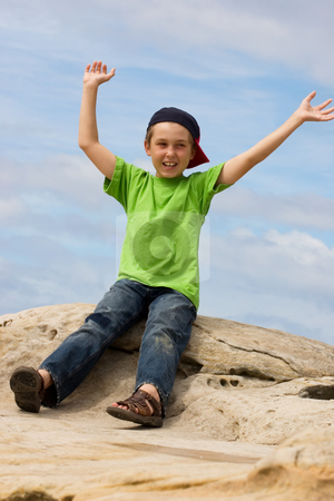 Extroverted Boy stock photo, Carefree child waving arms gregariously overhead by Leah-Anne Thompson