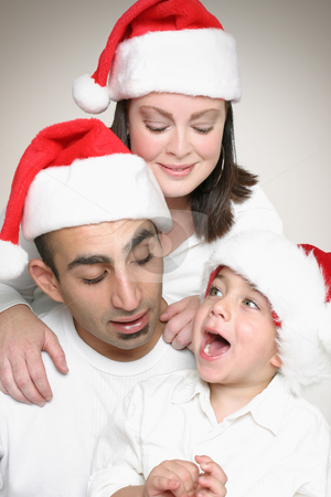Family enjoying Christmas stock photo, Multicultural family enjoyment at Christmas time. by Leah-Anne Thompson