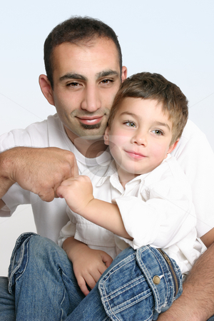 Father and son best mates stock photo, Father and son make a friendly pact. by Leah-Anne Thompson