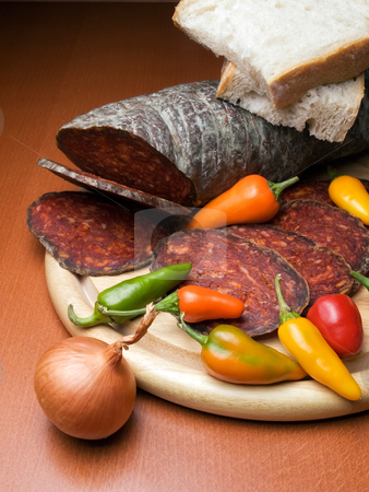 Kulen sausage stock photo, Kulen is a type of flavoured sausage made of minced pork that is traditionally produced in Croatia. by Sinisa Botas