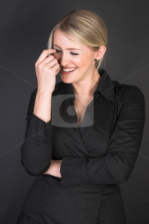 Beautiful Businesswoman stock photo, Laughing Blond Businesswoman against a black background by Carla Booysen