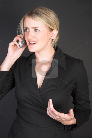 Beautiful Businesswoman stock photo, Worried businesswoman in conversation over the telephone by Carla Booysen