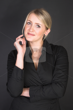 Beautiful Businesswoman stock photo, Beautiful Businesswoman wearing a black top against a black background by Carla Booysen