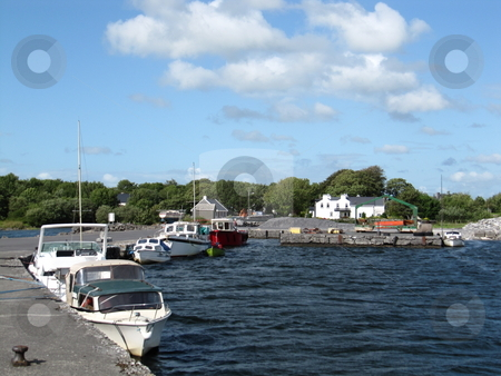 Boats at a pier stock photo, Some boats moored at a pier on Lough Corrib, County Galway, Ireland by Michael O'Connell