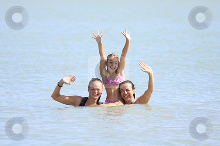 Three nice girls stock photo, Three nice girls are waving from the water cheerfully by ARPAD RADOCZY