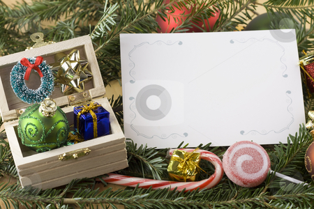 Wooden chest with blank Christmas card stock photo, Wooden chest with bauble, present, wreath and bow and blank Christmas card by Lee Barnwell