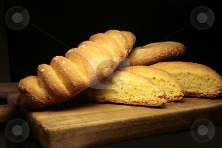 Bread stock photo, Close up of baked bread on black background by Marina Magri