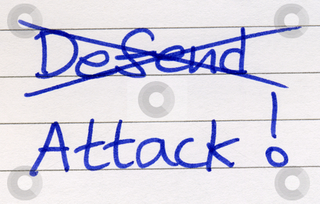 Crossing out defend and writing attack. stock photo, Crossing out defend and writing attack. by Stephen Rees