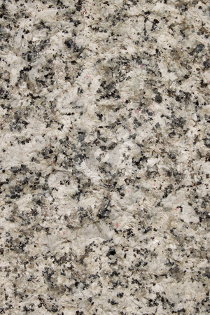 Natural white granite rough stone surface close up background. stock photo, Natural white granite rough stone surface close up background. by Stephen Rees