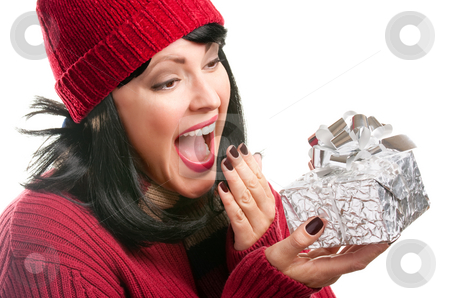 Pretty Woman Holding Holiday Gift stock photo, Happy, Attractive Woman Holds Holiday Gift Isolated on a White Background. by Andy Dean