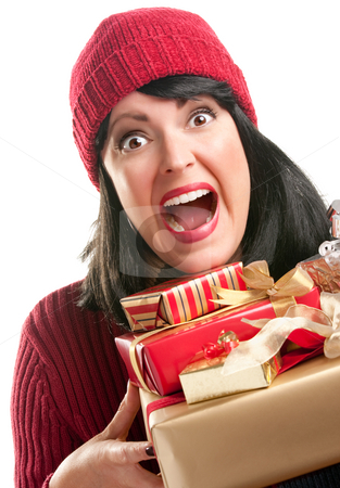 Pretty Woman Holding Holiday Gifts stock photo, Happy, Attractive Woman Holds Holiday Gifts Isolated on a White Background. by Andy Dean