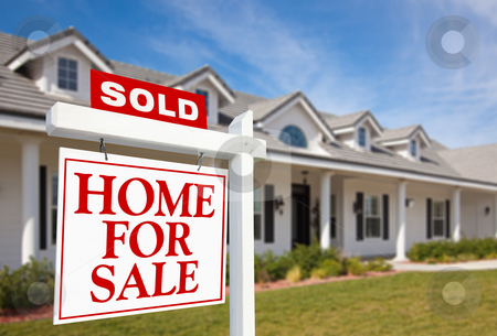 Sold Home For Sale Sign and New Home stock photo, Sold Home For Sale Sign in front of Beautiful New Home. by Andy Dean