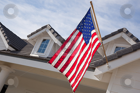 Abstract House Facade & American Flag stock photo, Abstract House Facade & American Flag Against a Blue Sky by Andy Dean