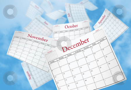 Time Passes stock photo, Calendar Pages being blown into the sky. by Mark Carrel