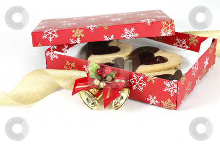 Christmas Box stock photo, A box filled with shortbread hearts.  Curling ribbon and bell decoration adorned box. by Leah-Anne Thompson