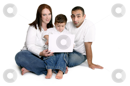 Family with child on computer stock photo, Parents spend time with small child on computer laptop. by Leah-Anne Thompson