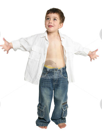 Toddler with arms outstretched stock photo, Toddler boy wearing blue jeans and white shirt stands with arms outstretched. by Leah-Anne Thompson