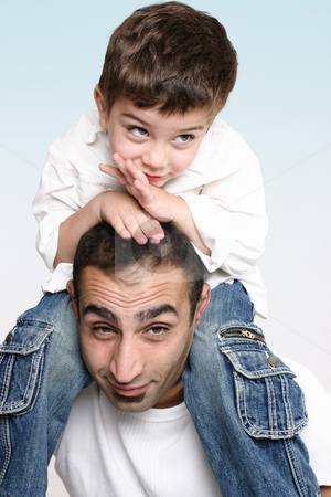 Spending time on Dad's shoulders stock photo, A child happily relaxes sitting on father's shoulders by Leah-Anne Thompson