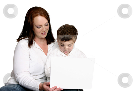 Early childhood learning stock photo, Early childhood education.   A toddler using a laptop computer. by Leah-Anne Thompson