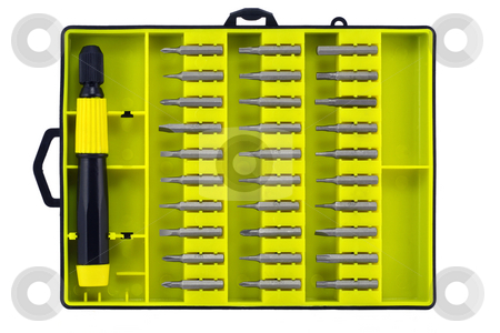Set of universal screw-drivers stock photo, Replaceable tips of screw-drivers and the holder in a yellow box. Isolated on white. by Aleksandr Volokov