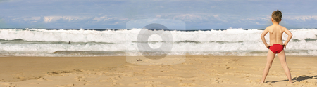 Beach Holiday panorama stock photo, A beach panorama and boy by Leah-Anne Thompson