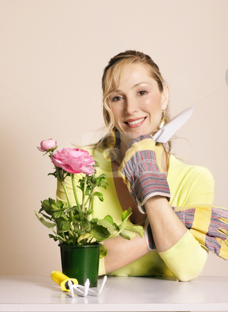 Gardener with tools and potted plant stock photo, Gardener with a potted plant by Leah-Anne Thompson