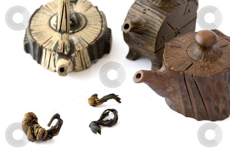 Chinese ceramic teapots stock photo, A close up view of Chinese ceramic teapots over white by Tito Wong