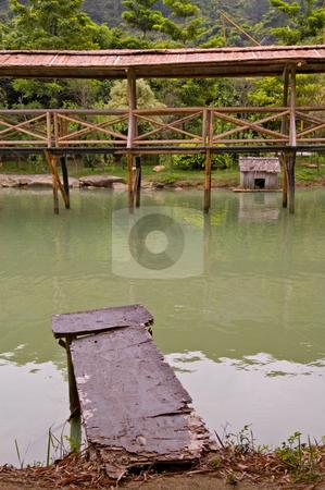 Wood arbor and walk bridge stock photo, Old wood arbor and walk bridge in river by Tito Wong