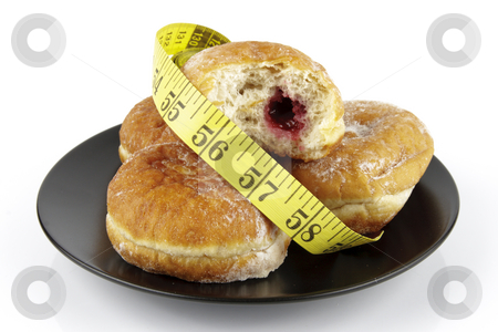 Doughnuts and Tape Measure stock photo, Black round plate of jam doughnuts with a yellow tape measure on a reflective white background by Keith Wilson
