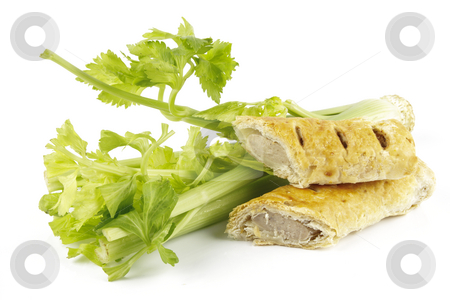 Celery and Sausage Roll stock photo, Contradiction between healthy food and junk food using celery and sausage roll on a reflective white background by Keith Wilson