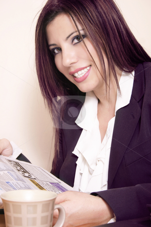 Smiling Businesswoman stock photo, Smiling brunette in office attire and newspaper by Leah-Anne Thompson