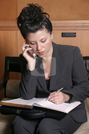 Getting the facts stock photo, A business woman taking down details by Leah-Anne Thompson