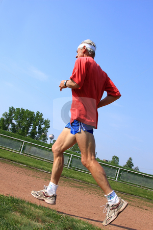 Senior runner stock photo, Senior runner while training for a competition by ARPAD RADOCZY