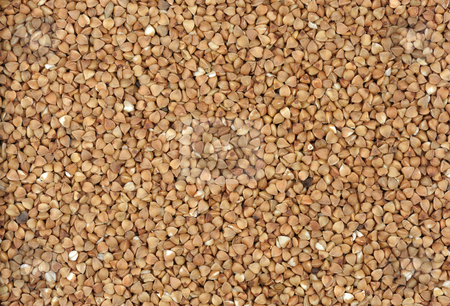 Buckwheat stock photo, Seeds of buckwheat close up on a white background. by Vladimir Blinov