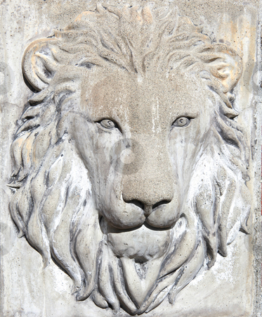 Lion stock photo, Lion's head in concrete. by OSCAR Williams