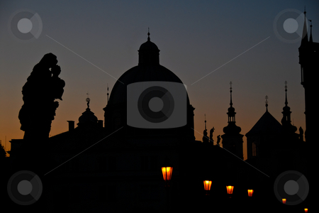 Praha at Dawn stock photo, Outlines of buildings, statues, and spires in Prague at dawn. by ALEX CHOW