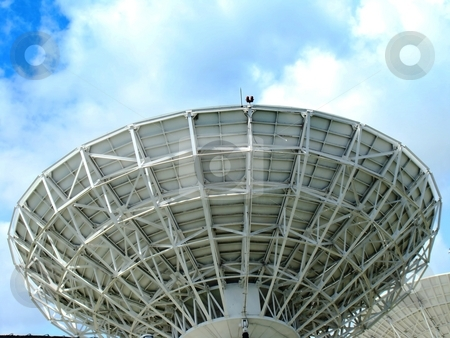 Telecommunication dish stock photo, Closeup of telecommunication dish against cloudy sky background. by Gowtum Bachoo